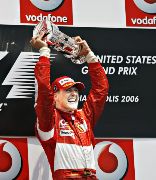 Germany's Michael Schumacher holds the winners trophy at the Formula One USGP at the Indianapolis Motor Speedway in Indianapolis on July 2, 2006. Schumacher, who drives for Italy car maker Ferrari, has now won the race a record 5-times. (UPI Photo/Tom Russo)
