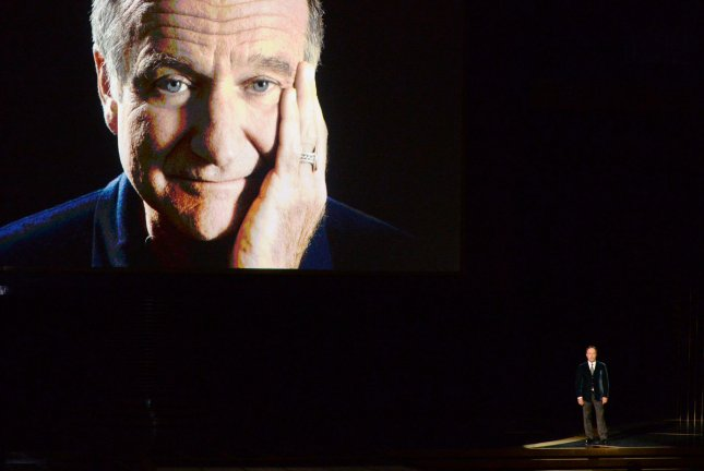 Robin Williams is seen on screen as Billy Crystal speaks during an In Memoriam tribute during the Primetime Emmy Awards at the Nokia Theatre in Los Angeles on August 25, 2014. UPI/Pat Benic.