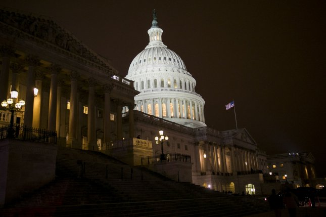 Voters in Tuesday's midterm elections will decide who is in control of Congress and cast ballots on a host of divisive issues. UPI File/Kristoffer Tripplaar/Pool