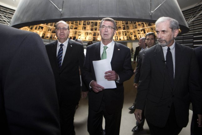 Dr. David Silberklang (R), head of Holocaust Research of Yad Yashem, escorts U.S. Defense Secretary Ashton Carter (C) with Israeli Defense Minister Moshe Yaalon (L) during a visit to the 'Hall of Names' at the Holocaust memorial Yad Vashem, in Jerusalem, Israel on July 21 2015. Carter visits Israel in a bid to ease concerns over the nuclear deal with Iran, saying the Jewish state remains the bedrock of American strategy in the region. Thousands of people took to the streets of New York City, N.Y., on Wednesday to protest against the recent nuclear deal between Iran and the United States. Photo by Abil Sultan/UPI