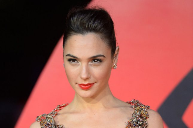 Wonder Woman star Gal Gadot attends the premiere of Batman v Superman: Dawn Of Justice at Odeon in London on March 22, 2016. Gadot offered her opinion on Wonder Woman stating that she represents love, justice and compassion. File Photo by Rune Hellestad/ UPI