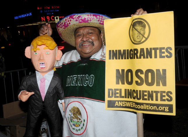 Protesters showed up outside NBC before Donald Trump hosted Saturday Night Live in New York City last year. Trump is still campaigning on a promise to build a wall along the Mexican border. File Photo by Dennis Van Tine/UPI