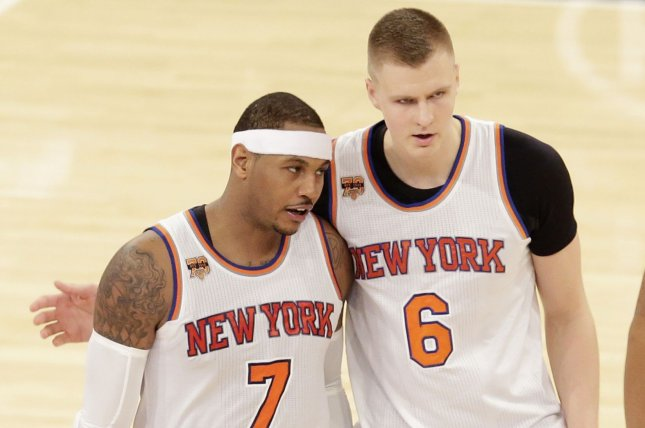8203b5275 New York Knicks Kristaps Porzingis and Carmelo Anthony walk to the bench  when a the out is called in the second half against the Detroit Pistons at  Madison ...
