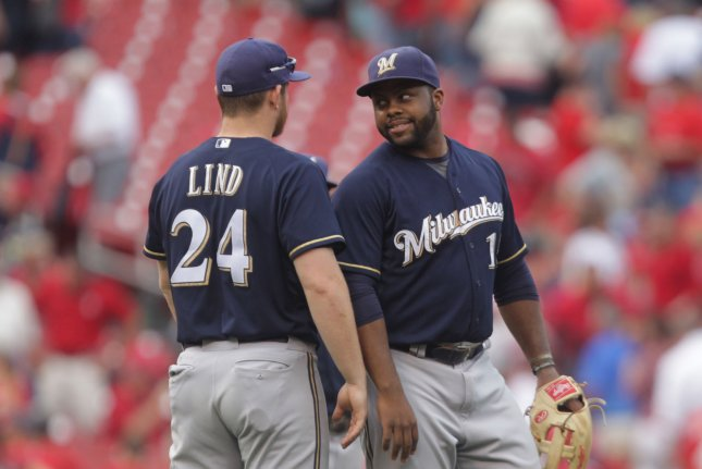 Milwaukee Brewers Jason Rodgers (R) talks with Adam Lind after the third out and a 8-4 win over the St. Louis Cardinals at Busch Stadium in St. Louis on September 27, 2015. Rodgers hit a grand slam home run in the ninth inning to power Milwaukee past St. Louis. Photo by Bill Greenblatt/UPI