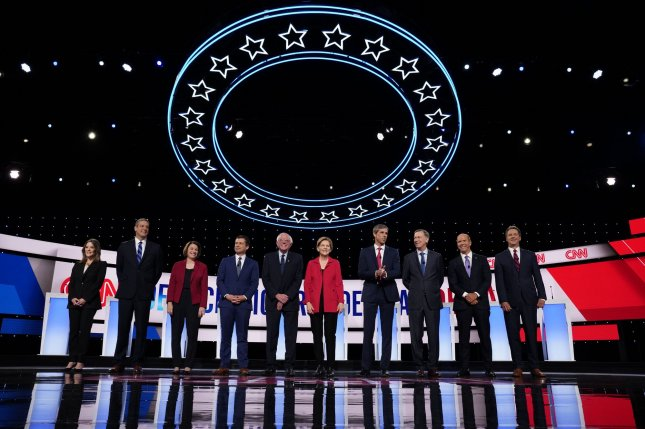 Democratic presidential candidates take the stage on the first day of the CNN Democratic Presidential Debate at the Fox Theater in Detroit on Tuesday. Photo by Edward M. PioRoda/CNN