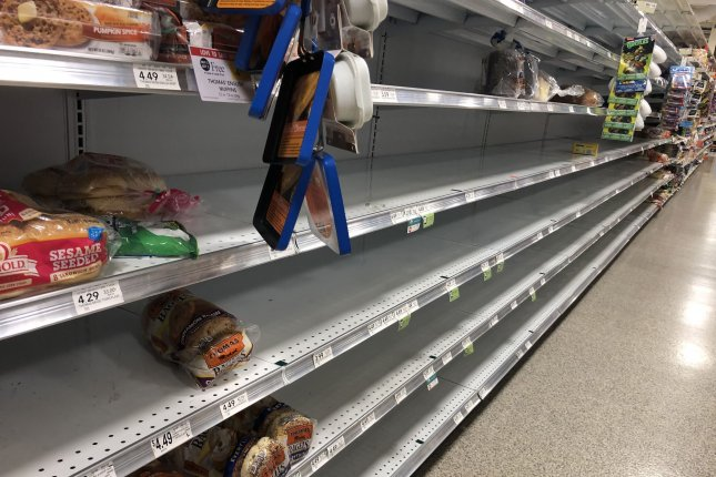 Bread shelves in Publix supermarket in Boynton Beach, Fla., are empty as shoppers prepare for the arrival of Hurricane Dorian on Friday. Photo by Gary I Rothstein/UPI.