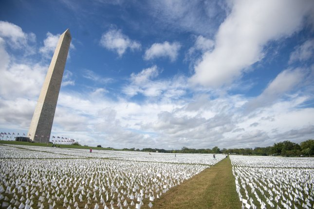 White flag installation marks 670,000 U.S. dead from COVID-19