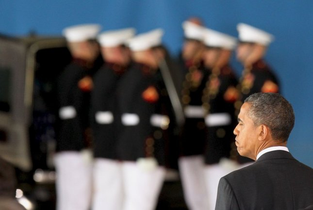 President Barack Obama watches while transfer cases are placed into hearses during the Transfer of Remains Ceremony marking the return to the United States of the remains of the four Americans killed this week in Benghazi, Libya, at Joint Base Andrews near Washington, DC on September 14, 2012. UPI/Molly Riley/Pool