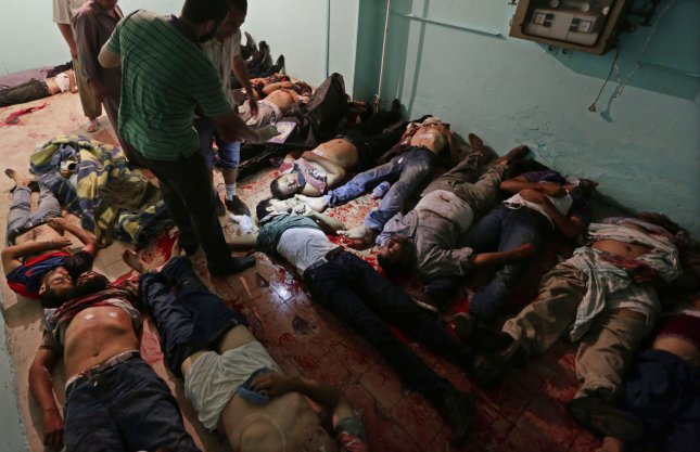 Bodies lie on the floor at a makeshift morgue in a hospital in Cairo following overnight violence, on July 8, 2013. At least 42 people were killed and more than 300 injured in the violent incident early on Monday morning at a sit-in demonstration in support for Egyptian President Mohamed Morsi. Supporters were demanding the release of Morsi, who was deposed by the Egyptian military last week. UPI/Ahmed Jomaa