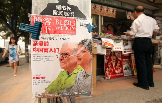 A popular Chinese magazine covering current events in China features a front page story on Warren Buffett and Bill Gates at a news stand in downtown Beijing September 20, 2010. Both Buffett and Gates will visit Beijing this month in a drive to promote philanthropy among China's super-rich. UPI/Stephen Shaver
