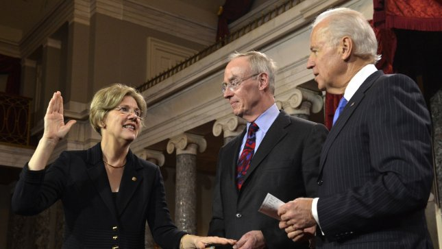 Newly-elected Sen. Elizabeth Warren (D-MA),(L) got straight to business in her first Banking, Housing and Urban affairs committee hearing this week when she asked surprised regulators when was the last time they took a Wall Street bank to court. (File/UPI/Mike Theiler)
