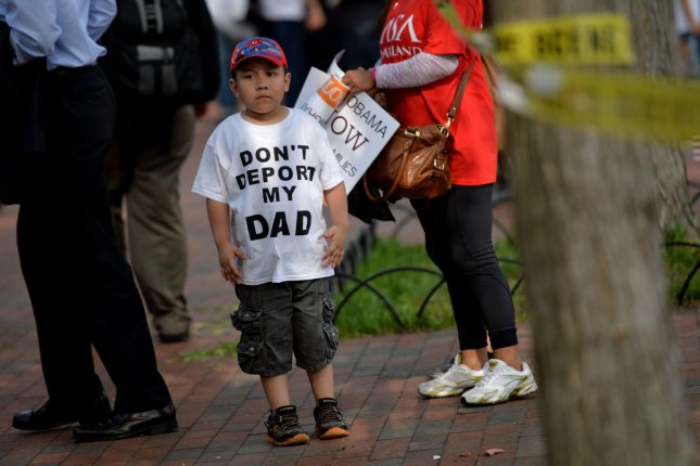 A child attends an immigration protest at the White House in Washington, D.C. on May 1, 2014. UPI/Kevin Dietsch