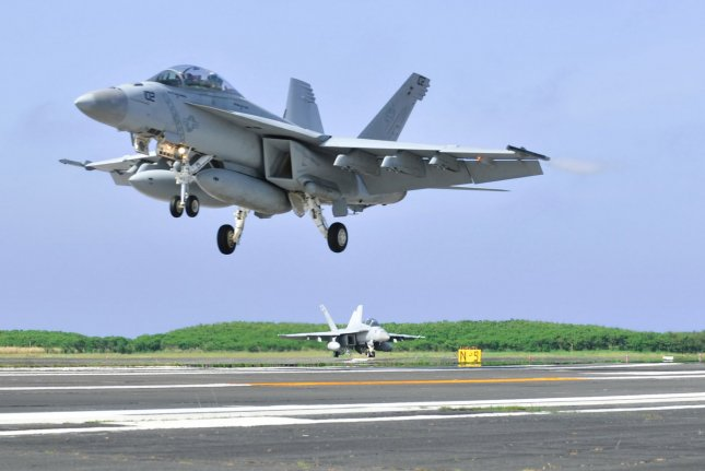 A U.S. Navy F/A-18F Super Hornet, similar to the one see here, was damaged when an SUV crashed through the gates at Lemoore Naval Air Station. The driver and passenger of the vehicle, which was being pursued by police, died. Photo by Keizo Mori/UPI