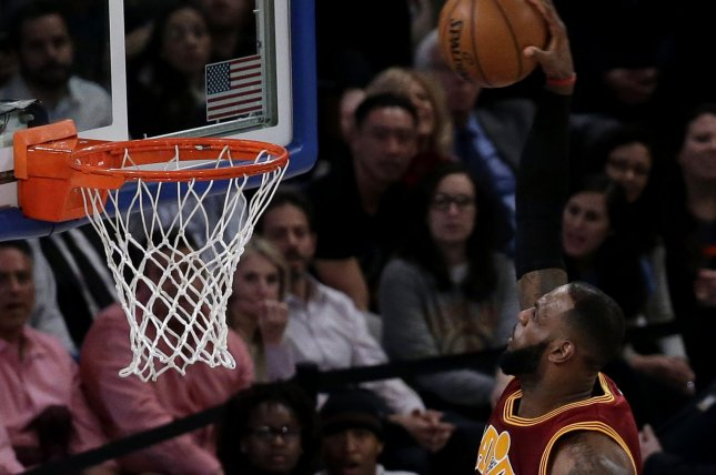 Cleveland Cavaliers LeBron James leaps and dunks the basketball. File photo by John Angelillo/UPI
