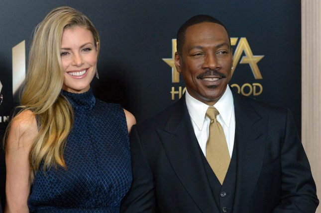 Eddie Murphy (R), pictured with Paige Butcher, welcomed son Max Charles with Butcher on Friday. File Photo by Jim Ruymen/UPI