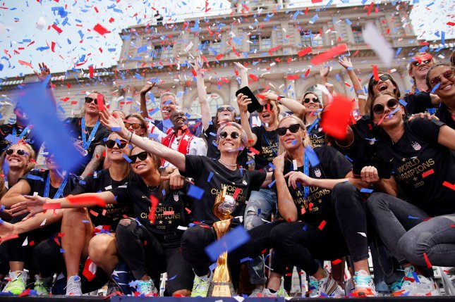 Confetti falls on Megan Rapinoe and the players of the United States Women's Soccer team as they celebrate at City Hall after a ticker tape parade at the Canyon of Heroes on Wednesday in New York City. Photo by John Angelillo/UPI