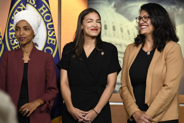 New York Rep. Alexandria Ocasio-Cortez, center, stands with Reps. Ilhan Omar of Minnesota (L) and Rashida Tlaib of Michigan during a July 15 press conference on Capitol Hill in Washington, D.C. Photo by Mike Theiler/UPI