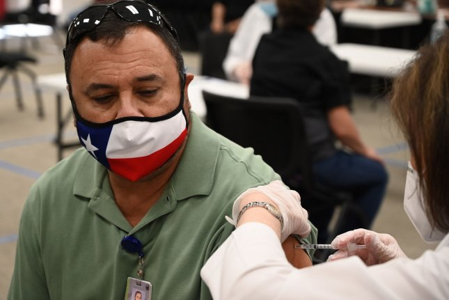Teachers and school employees in Wylie, Texas, receive the COVID-19 vaccine in March. File Photo by Ian Halperin/UPI