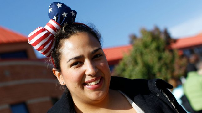Julie Martinez shows off her stars and stripes headband after voting in Alexandria, Virginia on November 6, 2012. UPI/Molly Riley