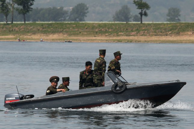 North Korean soldiers patrol the banks of the Yalu River near Sinuiju, in Liaoning Province, on May 28, 2015. The Pentagon is still assessing the degree to which North Korean buildup is going on despite the agreement between Seoul and Pyongyang that was reached on Tuesday. Photo by Stephen Shaver/UPI