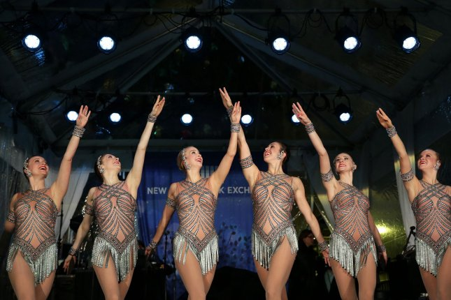 Radio City Rockettes perform at the ceremonies for the 93rd annual Christmas Tree lighting at the closing bell at the New York Stock Exchange on Wall Street in New York City on December 1. The famed dance troupe is to perform at Donald Trump's inauguration ceremony on Jan. 20. Photo by John Angelillo/UPI