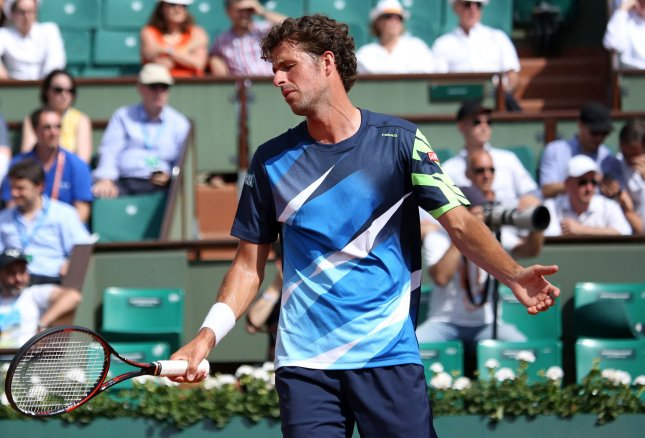Robin Haase reacts after a shot during the French Open. Photo by David Silpa/UPI