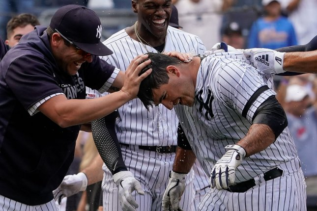 New York Yankees slugger Mike Ford (R) became the first rookie in franchise history to hit a walk-off, pinch-hit home run when he hit a solo shot against the Oakland Athletics on Sunday in New York. Photo by Ray Stubblebine/UPI