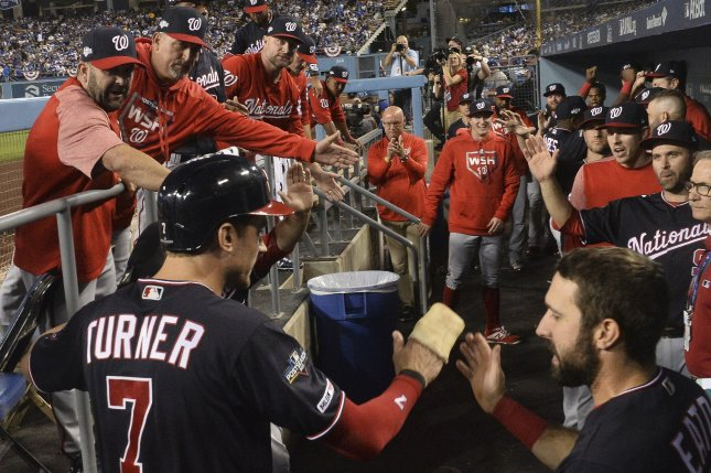 Washington Nationals shortstop Trea Turner (7) is congratulated after hitting a double in the first inning of Game 2 of the National League Division Series on Friday at Dodger Stadium in Los Angeles. Photo by Jim Ruymen/UPI