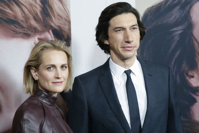 Marriage Story star Adam Driver (R) poses with his wife Joanne Tucker. Driver won Best Actor at the Gotham Awards. File Photo by John Angelillo/UPI