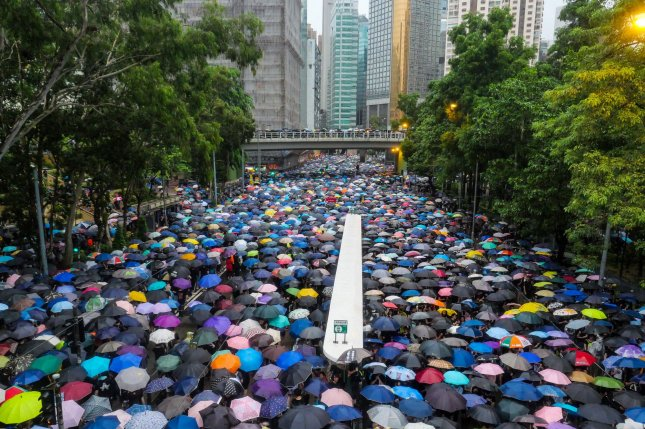 A crowd of protesters under umbrellas leave an anti-government rally in Hong Kong's Victoria Park last August. Organizers estimated 1.7 million people turned out for the demonstration. Photo by Thomas Maresca/UPI