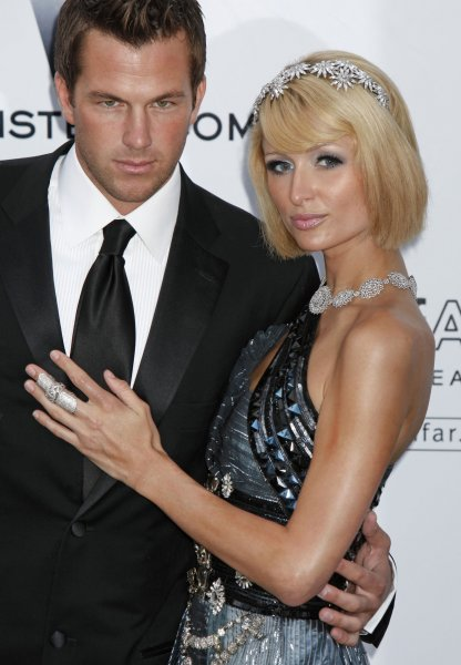 Socialite Paris Hilton and boyfriend Doug Reinhardt arrive at the amfAR Cinema Against AIDS 2009 gala at the Hotel du Cap in Antibes, France on May 21, 2009. The event, held each year during the Annual Cannes Film Festival, raises funds for AIDS research. (UPI Photo/David Silpa)