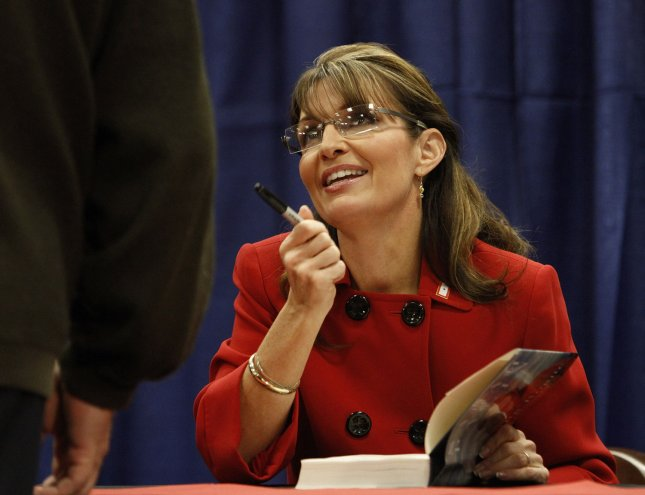 Former Alaska Gov. Sarah Palin talks with a customer at a signing for her book Going Rogue: An American Life in Grand Rapids, Mich., Nov. 18, 2009. UPI/Brian Kersey