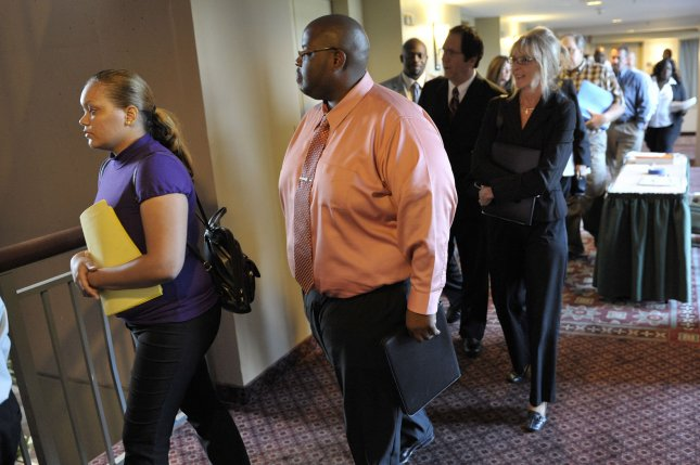 Employment seekers line up as a job fair opens in Lombard, Illinois in 2011. UPI/Brian Kersey