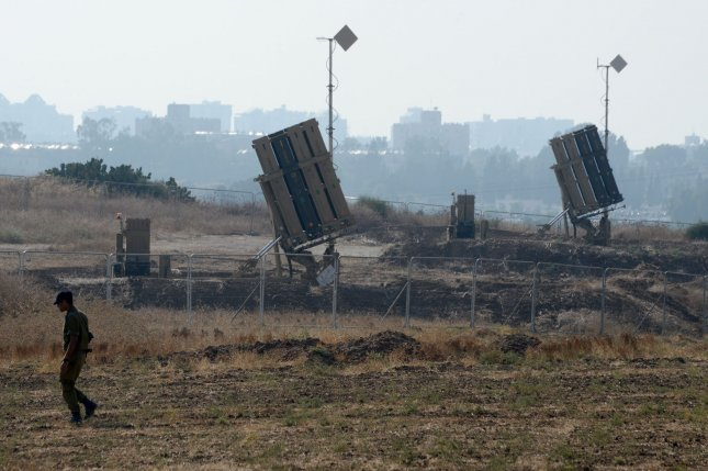 Israeli defense firm Rafael unveiled its Drone Dome, an anti-drone variant of its Iron Dome anti-rocket weapon this month. Pictured, an Israeli soldier walks near an Iron Dome defense system that is used to intercept rockets from Gaza in Ashdod, Israel, July 21, 2014. File photo by Debbie Hill/UPI