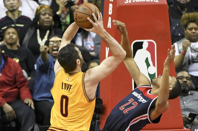 Cleveland Cavaliers forward Kevin Love (0) is called for a foul against Washington Wizards forward Otto Porter Jr. (22) on Feb. 6, shortly before he was sidelined by injury. He's expected to return to the court for a 4-game road trip. Mark Goldman/UPI