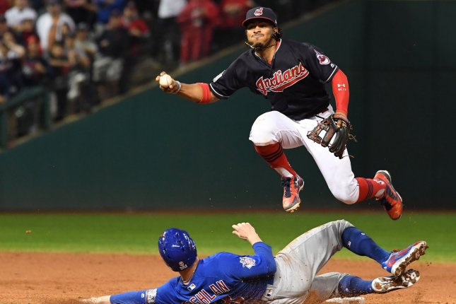 Chicago Cubs' Chris Coghlan (L) is forced out at second base by Cleveland Indians shortstop Francisco Lindor during the ninth inning of World Series Game 7 November 2 at Progressive Field in Cleveland. File photo by Pat Benic/UPI