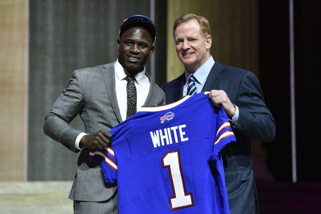 Tre'Davious White poses for photographs with NFL Commissioner Roger Goodell after being selected by the Buffalo Bills as the 27th overall pick in the 2017 NFL Draft at the NFL Draft Theater in Philadelphia, PA on April 27, 2017. Photo by Derik Hamilton/UPI