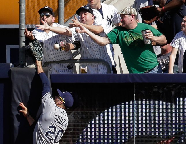Steven Souza Jr. of the Tampa Bay Rays attempts to make a catch at the wall. Photo by Ray Stubblebine/UPI