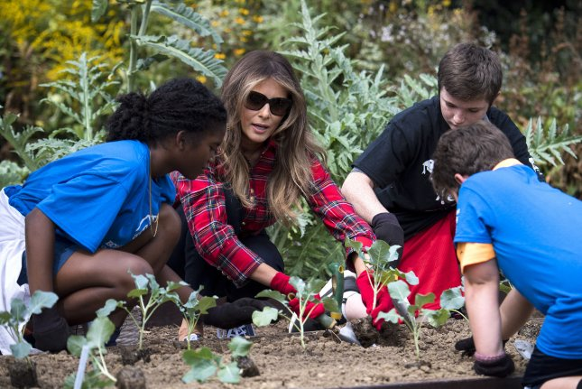 85468845 First lady Melania Trump plants broccoli with children from the Boys &  Girls Club of Greater Washington during an event in the White House garden  in ...