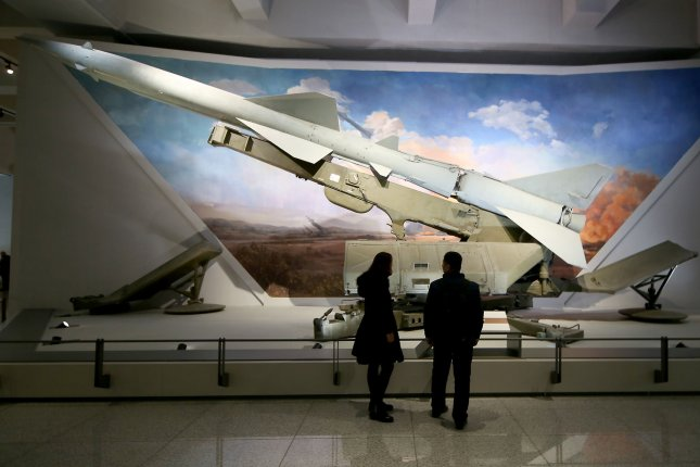 Chinese visitors look at a ground-to-air missile on display at the Military Museum in Beijing. Chinese media says a new weapon could be deployed by 2020. File Photo by Stephen Shaver/UPI