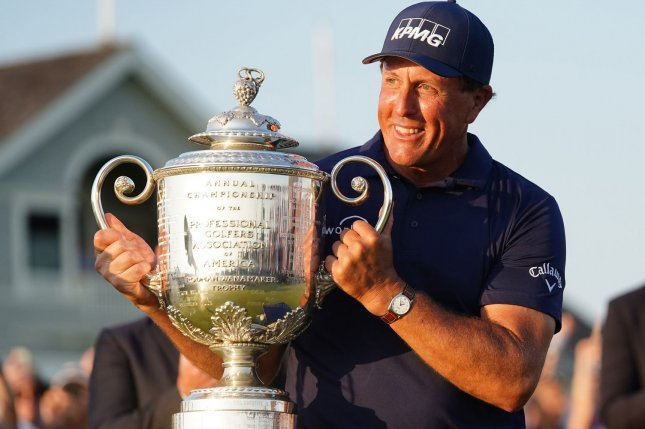 Phil Mickelson grins as he lifts the Wanamaker Trophy after winning the 103rd PGA Championship on Sunday at Kiawah Island Golf Resort Ocean Course in Kiawah Island, S.C. May 23, 2021. Photo by Richard Ellis/UPI