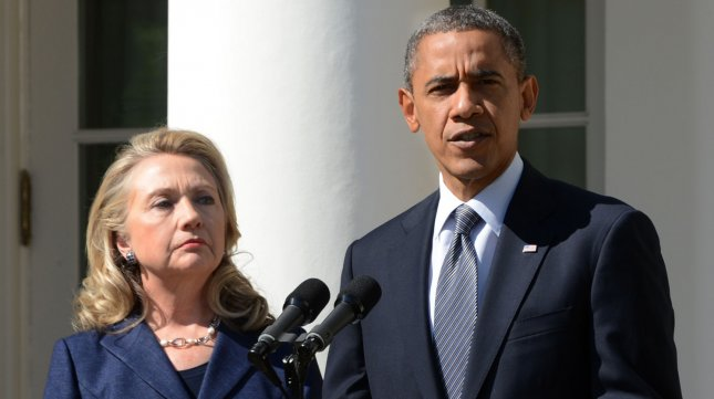 United States President Barack Obama makes a statement on the violence in Libya as Secretary of State Hillary Clinton listens in the Rose Garden of the White House on September 12, 2012 in Washington, DC. UPI/Pat Benic
