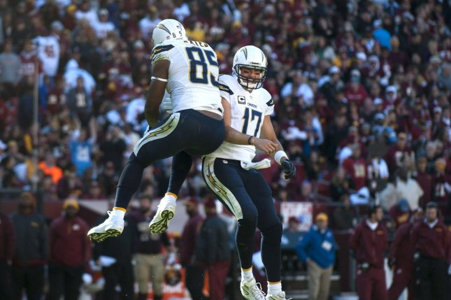 San Diego Chargers quarterback Philip Rivers (17) celebrates with teammate Ladarius Green after Rivers threw a 15-yard touchdown to Eddie Royal during the second quarter against the Washington Redskins at FedEx Field in Landover, Maryland on November 3, 2013. (File/UPI/Kevin Dietsch)
