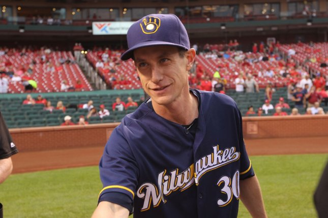 Milwaukee Brewers manager Craig Counsell greets umpires at home plate before a game against the St. Louis Cardinals at Busch Stadium in St. Louis on September 8, 2016.Photo by Bill Greenblatt/UPI