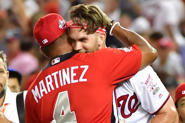 Washington Nationals star Bryce Harper (R) of the National League hugs Nationals Manager David Martinez (4) after winning the 2018 Home Run Derby on July 16 at Nationals Park in Washington, D.C. Photo by Kevin Dietsch/UPI