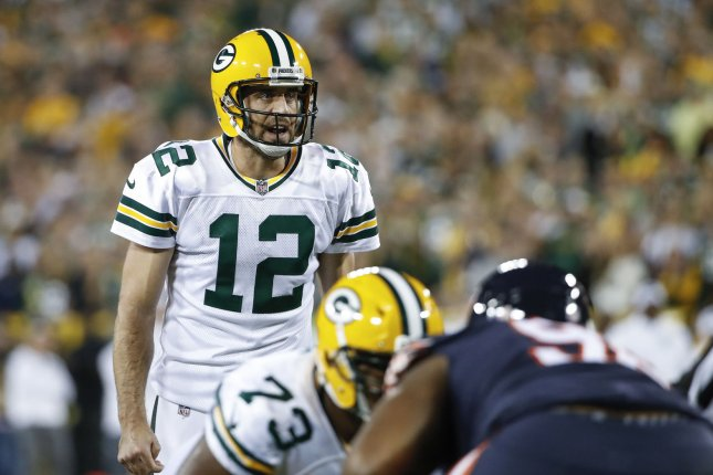 57b30f34046 Green Bay Packers quarterback Aaron Rodgers (12) directs his team against  the Chicago Bears during the first half in 2017 at Lambeau Field in Green  Bay.