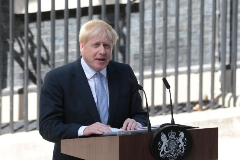 British Prime Minister Boris Johnson speaks to reporters outside No. 10 Downing St. Wednesday. Photo by Hugo Philpott/UPI