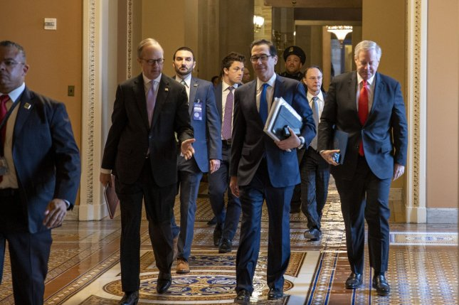 White House Legislative Affairs Director Eric Ueland (L), Treasury Secretary Steven Mnuchin (C) and Acting Chief of Staff Mark Meadows (R) walk from a meeting with Senate majority leader Mitch McConnell on Capitol Hill in Washington, D.C., on Tuesday. Photo by Tasos Katopodis/UPI