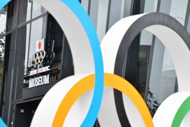 The iconic Olympic rings are seen near National Stadium in Tokyo, Japan, on March 29, 2020. File Photo by Keizo Mori/UPI