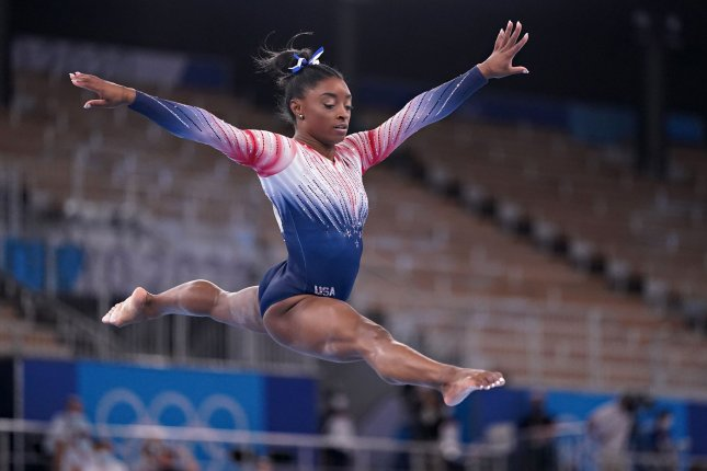 Simone Biles performs on the balance beam during the women's individual apparatus artistic gymnastics final at the Ariake Gymnastics Centre at the Tokyo Olympic Games on Tuesday. Photo by Richard Ellis/UPI